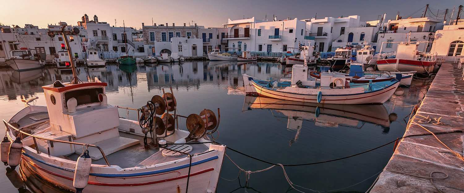 Port with typical white marble houses in the Cyclades