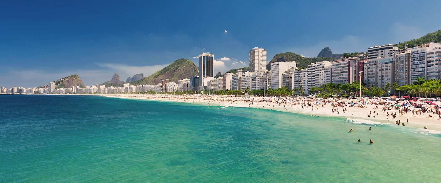 Beautiful city beach with turquoise sea in Rio de Janeiro
